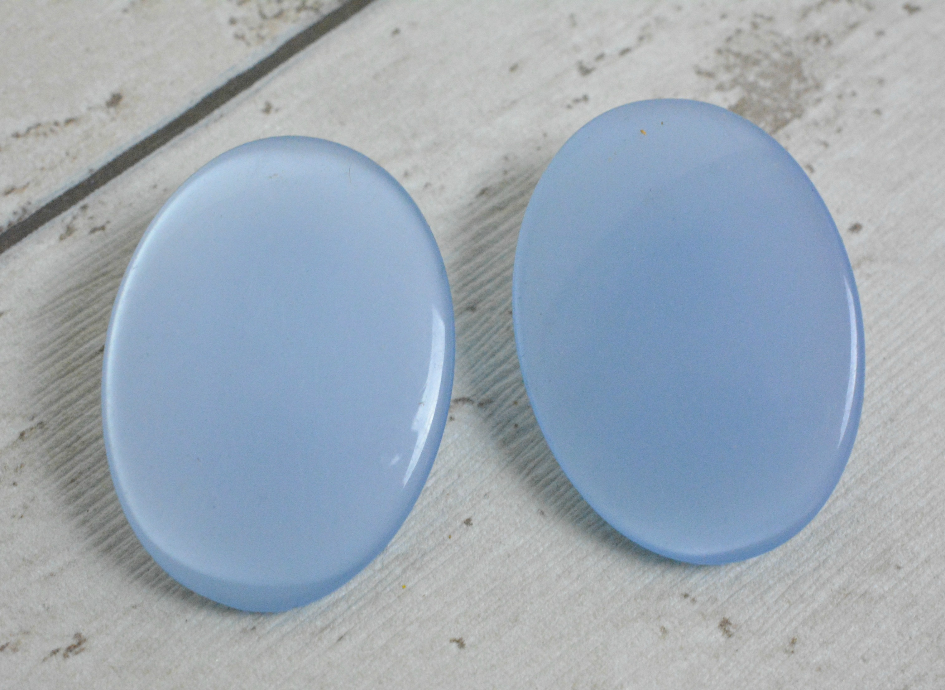 Blue Plastic oval earring off card