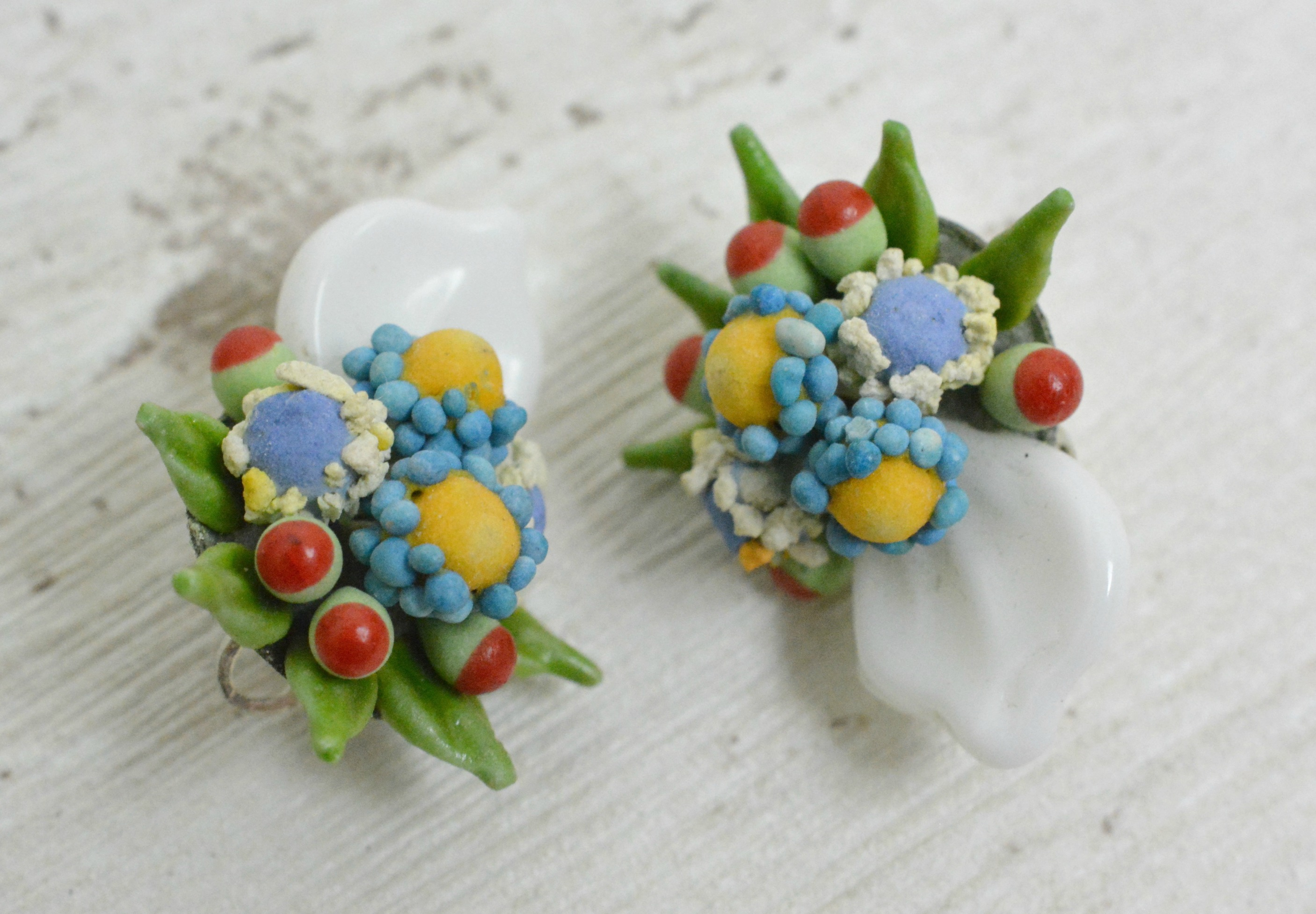 Plastic flower clip on earrings