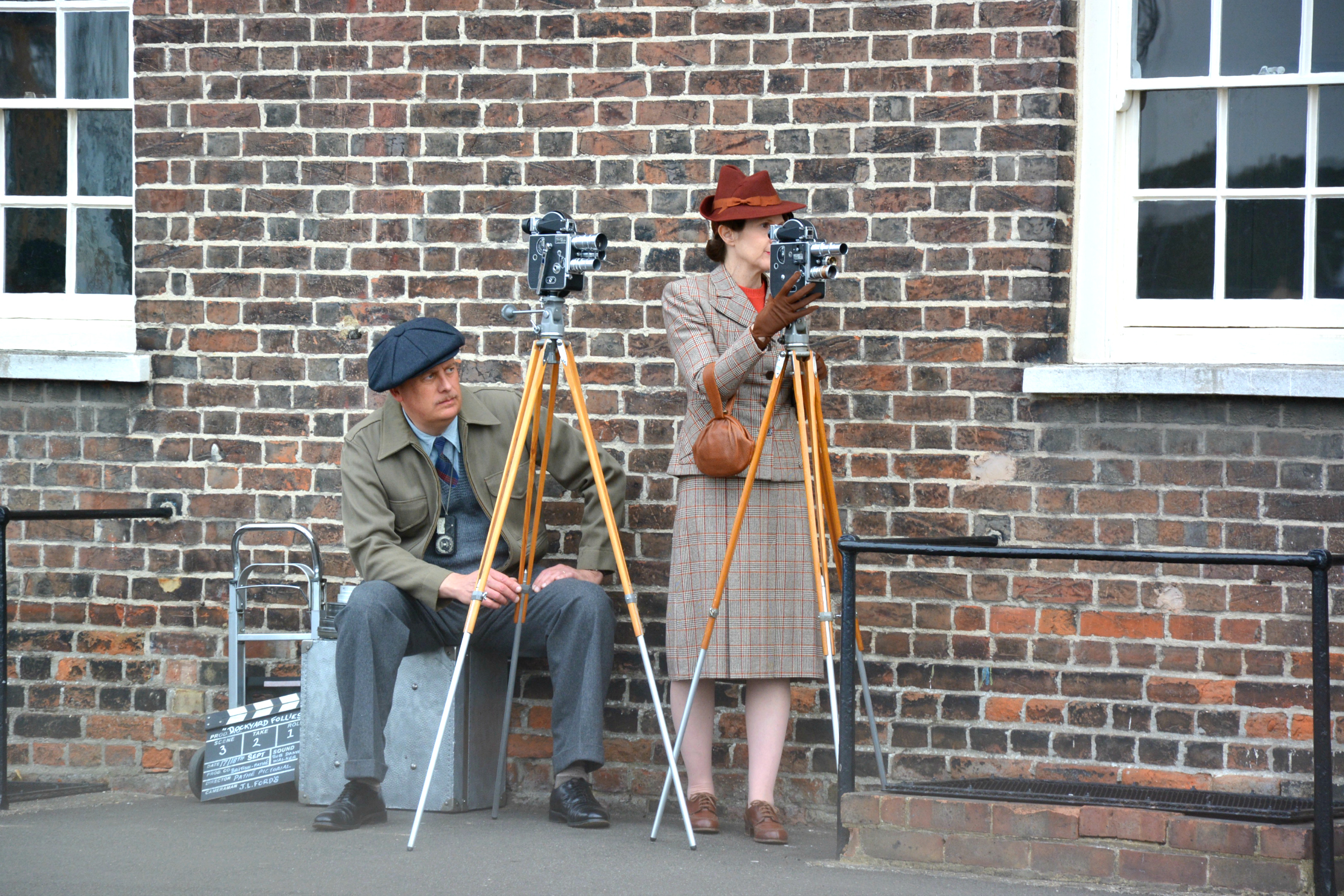salute-to-the-40s-couple-with-cameras